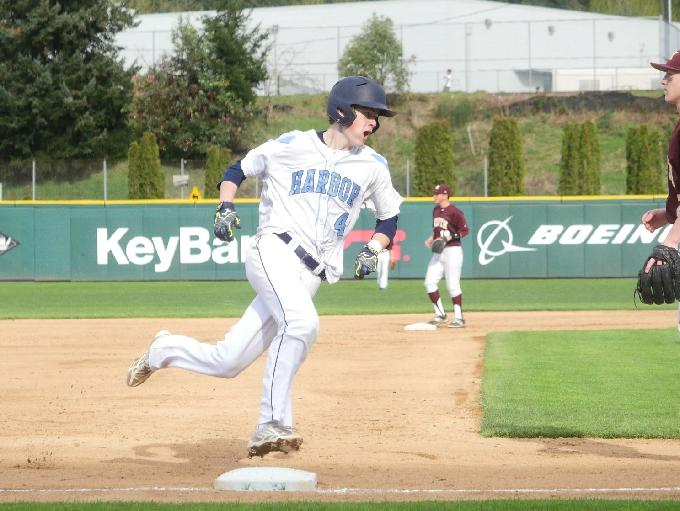Gig Harbor's Chad Stevens rounds third and heads home following Garrett Lean's double to left field.