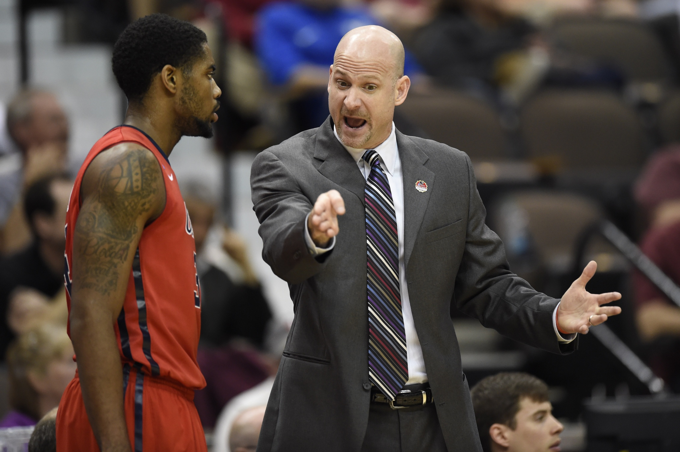 Mississippi Rebels head coach Andy Kennedy talks with Rebels forward Aaron Jones (34) in the first half of a game in the second round of the 2015 NCAA Tournament at Jacksonville Veteran Memorial Arena. Mandatory Credit: John David Mercer-USA TODAY Sports