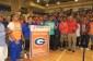 The Bishop Gorman football team and former coach Tony Sanchez accept the Super 25 championship banner (Photo: Bishop Gorman)