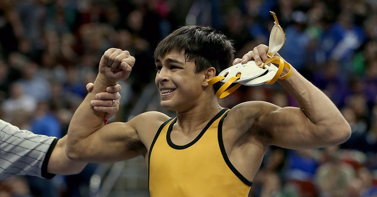 Bettendorf's Fredy Stroker wins in the finals of the 3A-145 match at the Iowa State Wresting Tournament (Photo: Michael Zamora/The Des Moines Register)