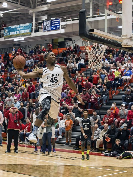 Louisville recruit Donovan Mitchell takes flight during the dunk contest at the 2015 Kentucky Derby Festival Basketball Classic  (Photo: Marty Pearl/Special to The Courier-Journal)