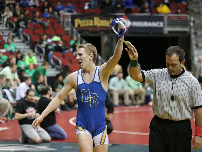 Cole Fox of Don Bosco has his hand raised in victory during the 2015 state duals wrestling meet in February. (Photo: Charlie Litchfield/The Register)