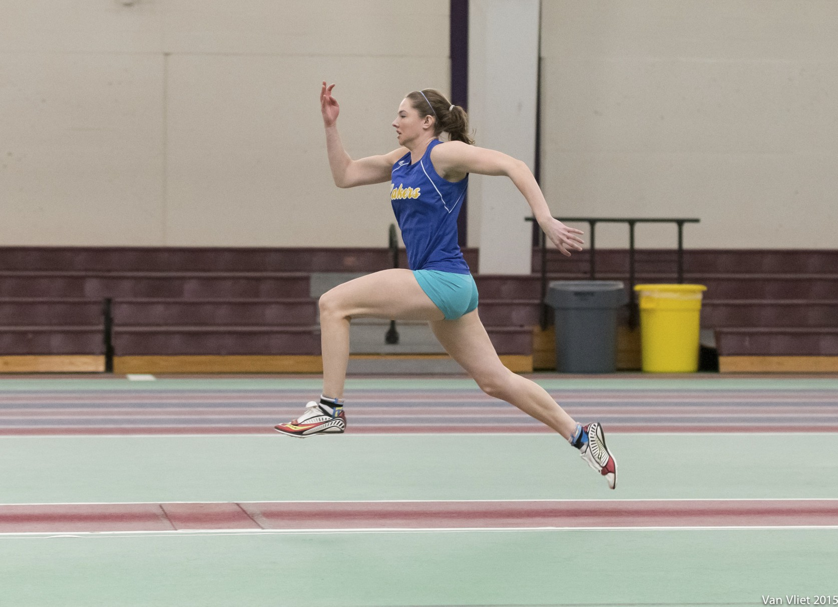 Kate Hall participates in the long jump at the New Balance Indoor Track Competition. Photo: Erich Sandoval