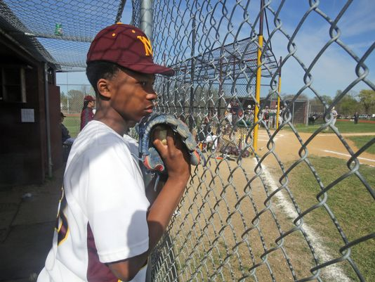 Mount Vernon high school's Shawn Harris watches the action from the dugout. (Photo: Seth Harrison, The Journal News)