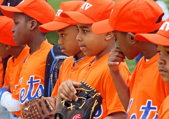 Members of the Mets, one of the teams in the Mount Vernon Reviving Baseball in the Inner Cities program youth league, stand together during opening day ceremonies. (Photo: Seth Harrison, The Journal News)