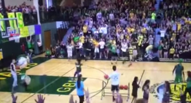 Glenbrook North science teacher Lindsey Berman's second half court shot in as many years (and attempts) earned her $1,000 for charity — YouTube screen shot