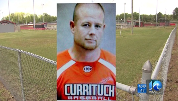 Longtime Currituck baseball coach and former player Justin Hill was suspended for forcing his players to spit in his face —WAVY video screen shot