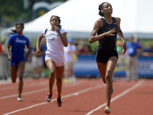 Rush-Henrietta's Sammy Watson, right, checks the clock as she crosses the finish line, winning the 400-meter dash (Division I) on June 12, 2015. (Photo: Adrian Kraus, Rochester Democrat & Chronicle)