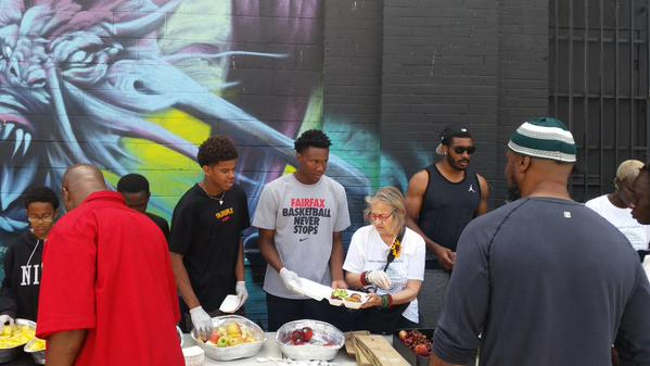 Fairfax (Los Angeles) basketball players help serve food Sunday at Skid Row in Los Angeles. Photo by Craig Wachs.