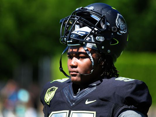 Defensive lineman Rashan Gary looks on from the sideline during The Opening at Nike World Headquarters in 2014. (Photo: Steve Dykes USA TODAY Sports)