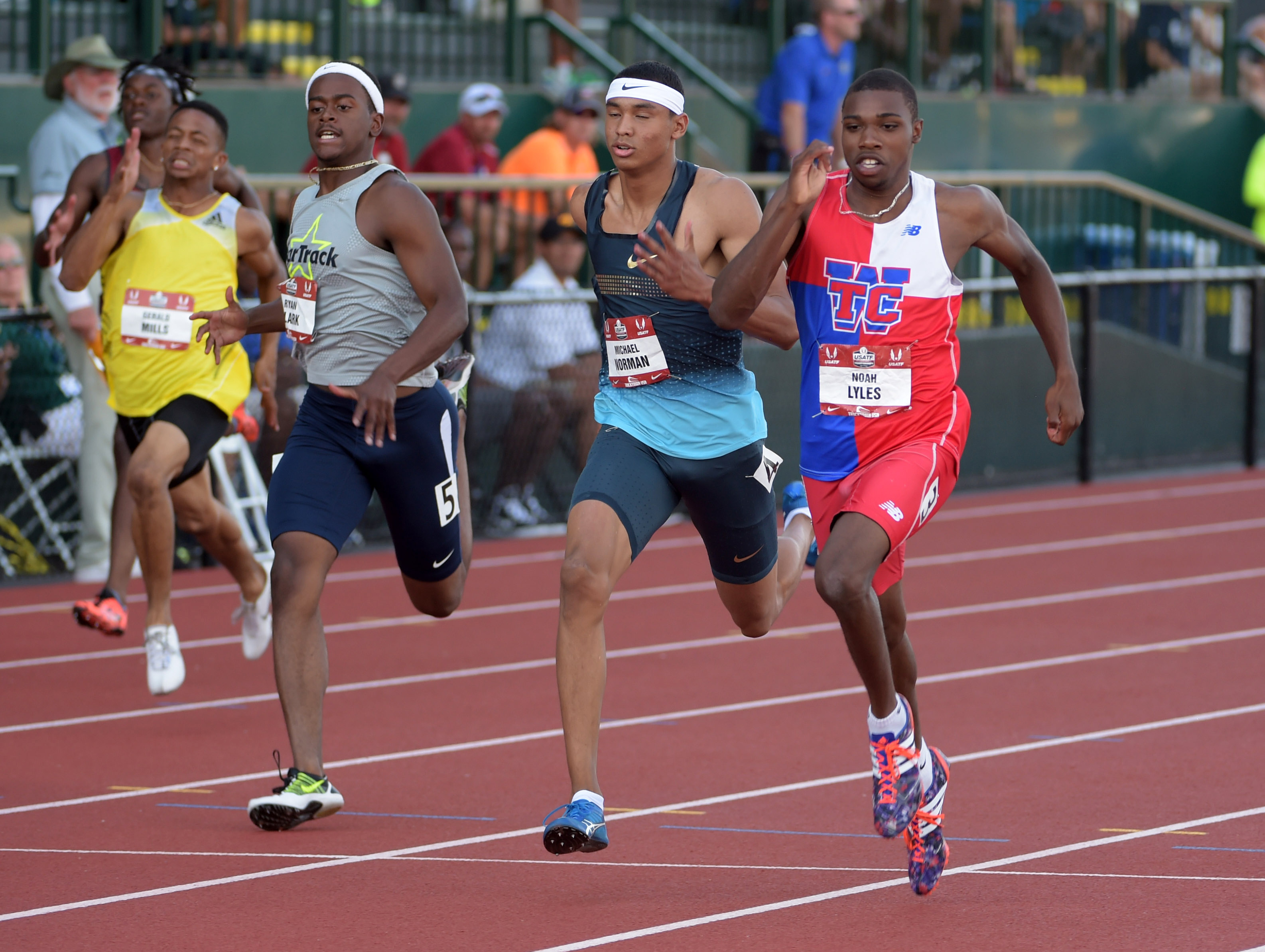 Noah Lyles (right) defeats Michael Norman (center) and Ryan Clark to win the junior 200m in 20.18 in the 2015 USA Championships. (Photo: Kirby Lee, USA TODAY Sports)
