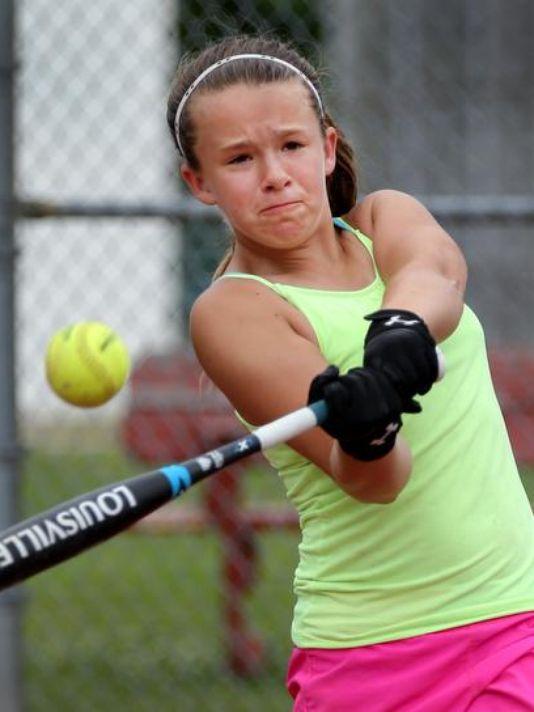 Lilly Stewart practices hitting as her mom, Melissa Stewart, pitches to her. (Photo: Matt Kryger / The Star)