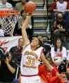 Candace Parker of Naperville, Ill. Central High School, dunks during the Powerade Jam Fest as part of the McDonald's All-American High School Team competition held at Carl Albert High School in Oklahoma City, Monday, March 29, 2004. (Photo: Ty Russell, The Oklahoman/AP).