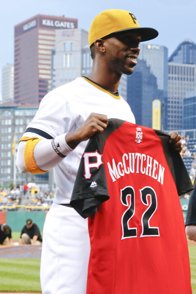 Pittsburgh Pirates' Andrew McCutchen shows his All-Star jersey after it was presented before a baseball game between the Pittsburgh Pirates and the St. Louis Cardinals, Sunday, July 12, 2015, in Pittsburgh. (AP Photo/Keith Srakocic)