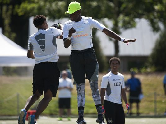 Quarterback Dwayne Haskins Jr. (center) celebrates with a receiver after throwing a touchdown during the morning practice at the Elite 11 football camp. (Photo: Godofredo Vasquez, USA TODAY Sports)