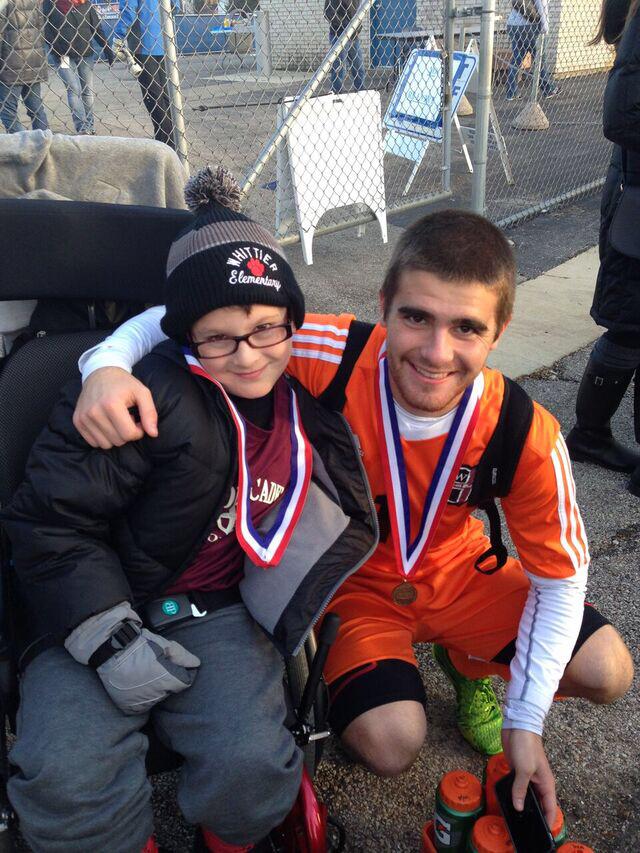 Atlas with goalie Drew Sezonov. (Photo: Scott Atlas)