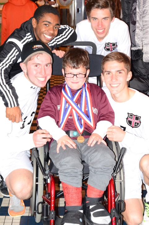 Matthew Atlas with members of the Wheaton Academy soccer team at their postgame celebration. (Photo: Scott Atlas)