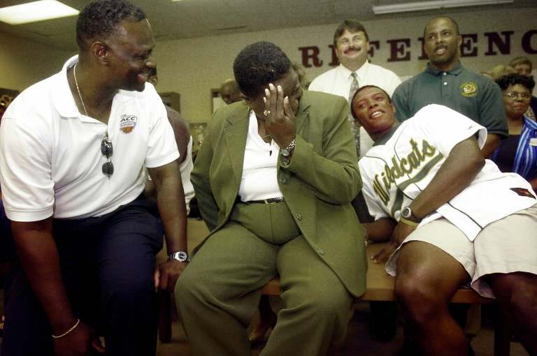 Justin Upton, right, and his parents Manny, left, and Yvonne, center, react as the Major League Baseball draft was delayed for the second time Tuesday, June 7, 2005. They were watching the draft with family and friends at Great Bridge High School in Chesapeake, Va. when the announcement for the first pick was delayed. Minutes later Upton was selected first by the Arizona Diamondbacks. (AP Photo/The Virginian-Pilot, Steve Earley