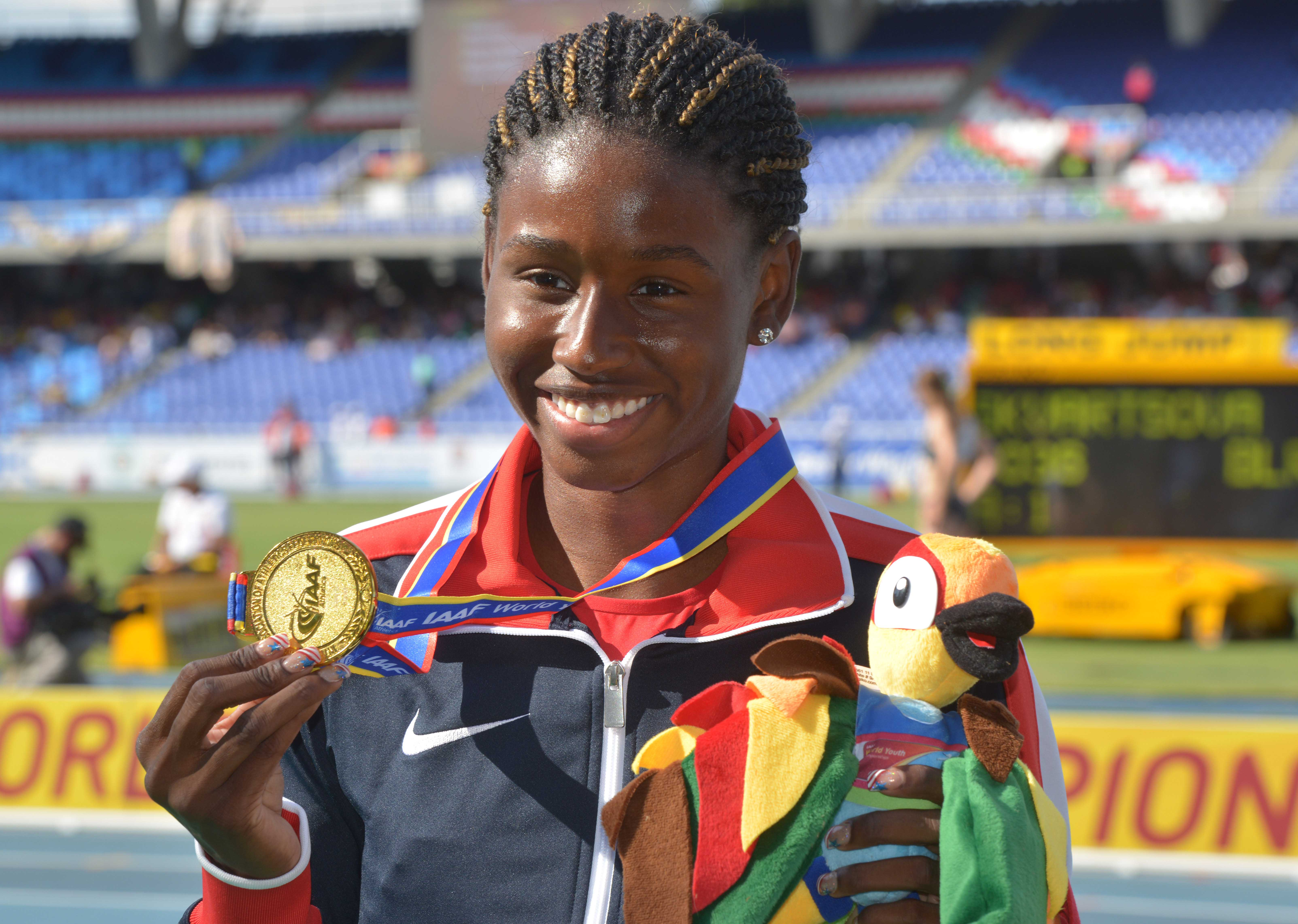 Candace Hill (USA) poses with the gold medal after winning the womens 200m in a world youth record 22.43 during the 2015 IAAF World Youth Championships. (Photo: Kirby Lee, USA TODAY Sports)