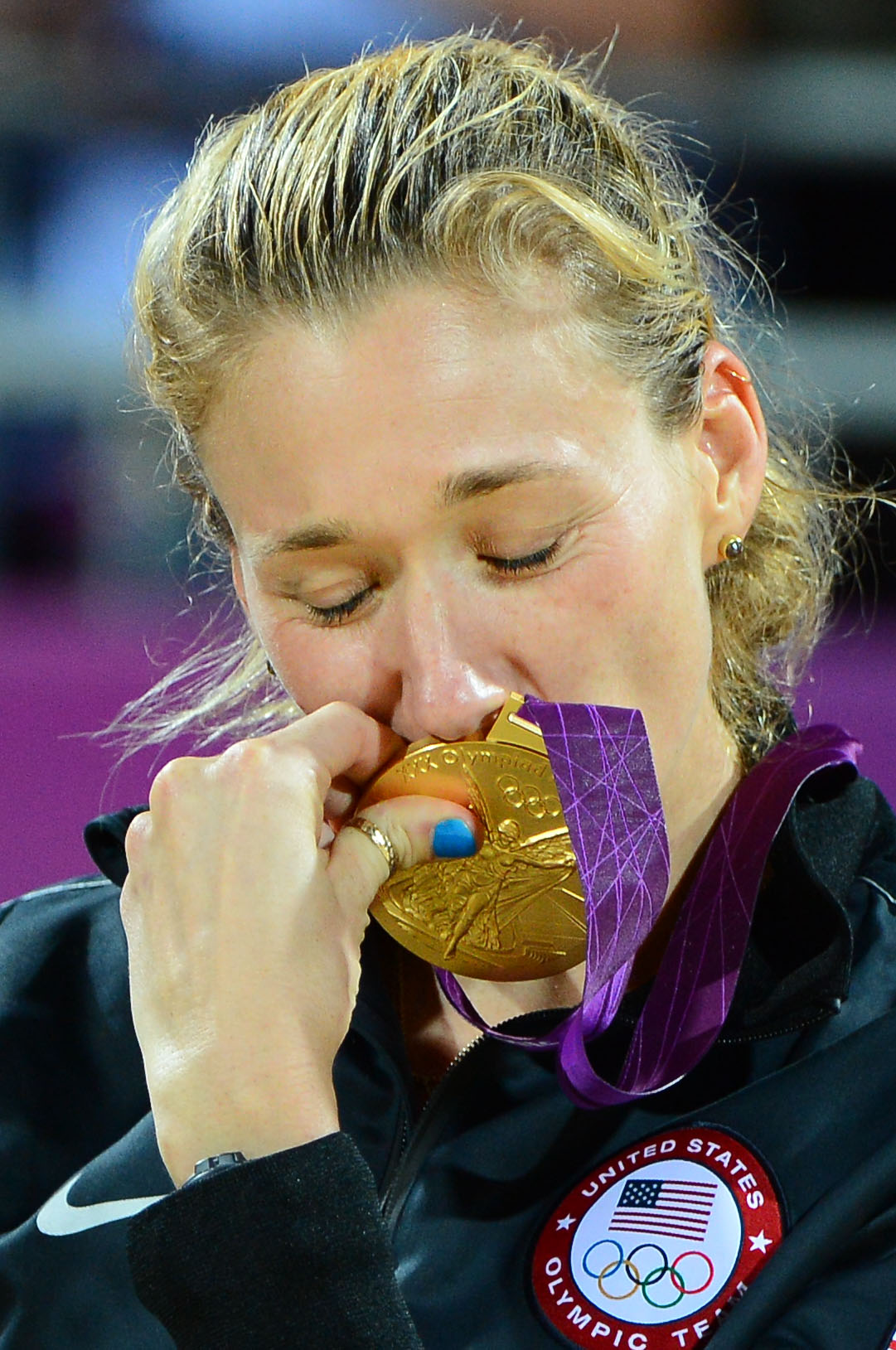 Kerri Walsh kisses her gold medal on the podium of the 2012 London Olympic Games. (Photo: Chris Hanewinckel, USA TODAY Sports)