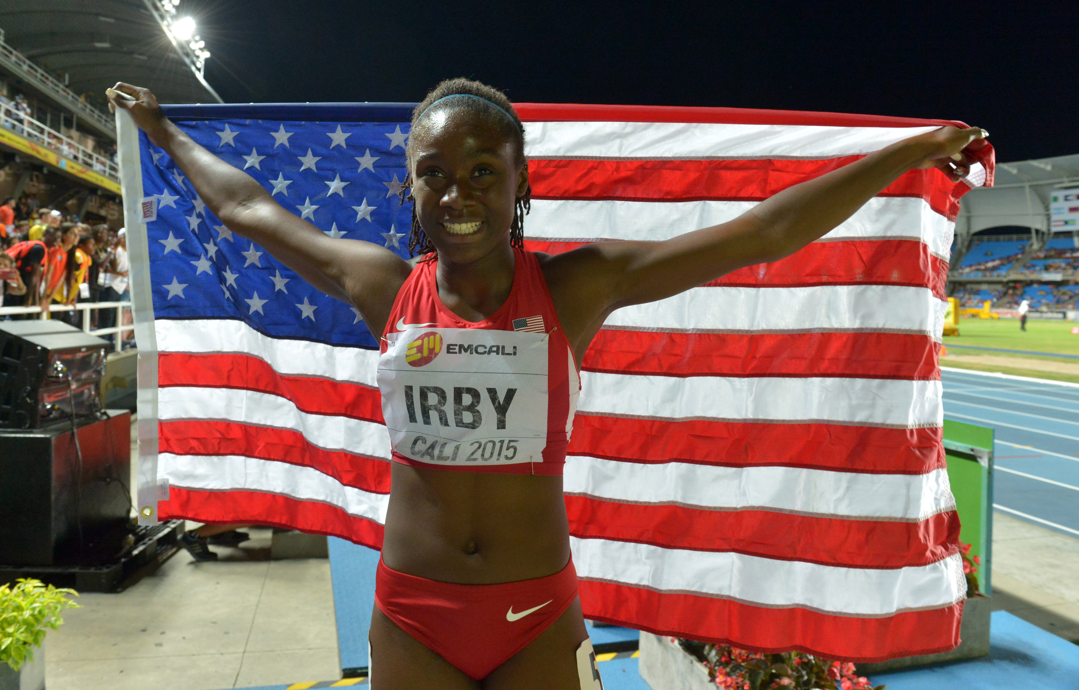 Lynna Irby (USA) poses with a United States flag after finishing second in the womens 400 meters (Photo: Kirby Lee, USA TODAY Sports)