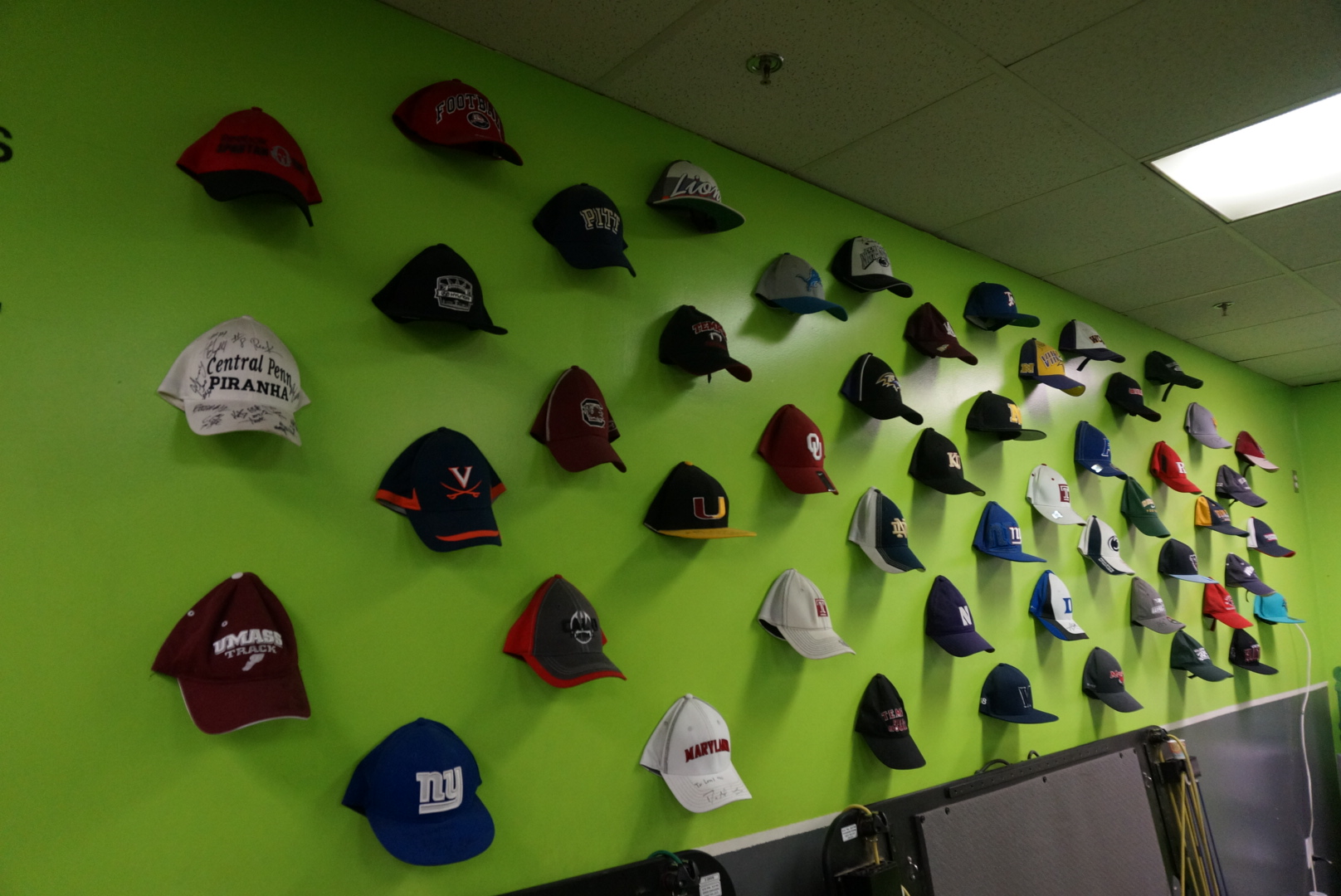 Trainer Greg Garrett says his wall of hats of players who have trained with him is his resume. (Photo: Greg Garrett).