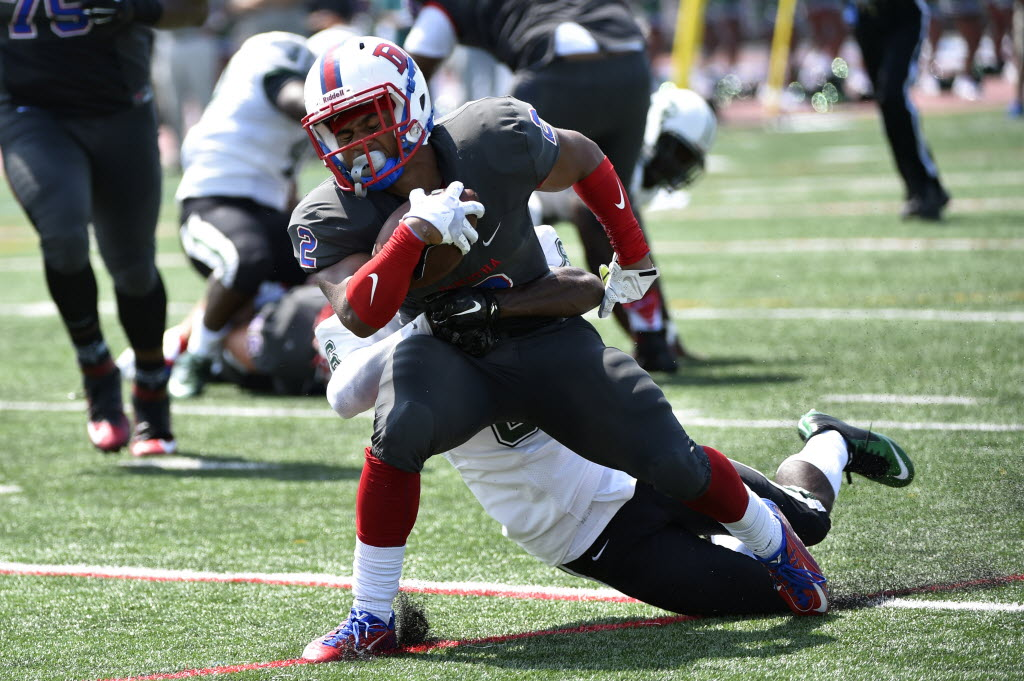 DeMatha Stags running back Lorenzo Harrison (2) is tackled by Miami Central Rockets Christopher Williams (6) during a game at Prince George's Sports and Learning Complex in Landover, Md. No. 5 DeMatha defeated No. 2 Miami Central 38-10. (Photo: Derik Hamilton-USA TODAY Sports)