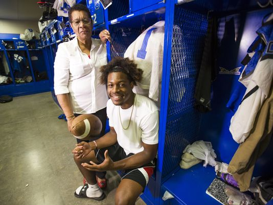 Chandler High's N'Keal Harry poses with his grandmother, Felna, in the football locker room August 25, 2015. Felna brought her grandson over from St. Vincent & the Grenadines for a better life. (Photo: Michael Chow, azcentral sports)