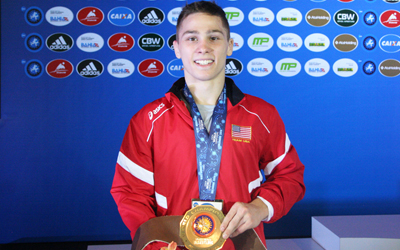 Spencer Lee shows off his gold medal at the world juniors in wrestling (Photo: USA Wrestling(