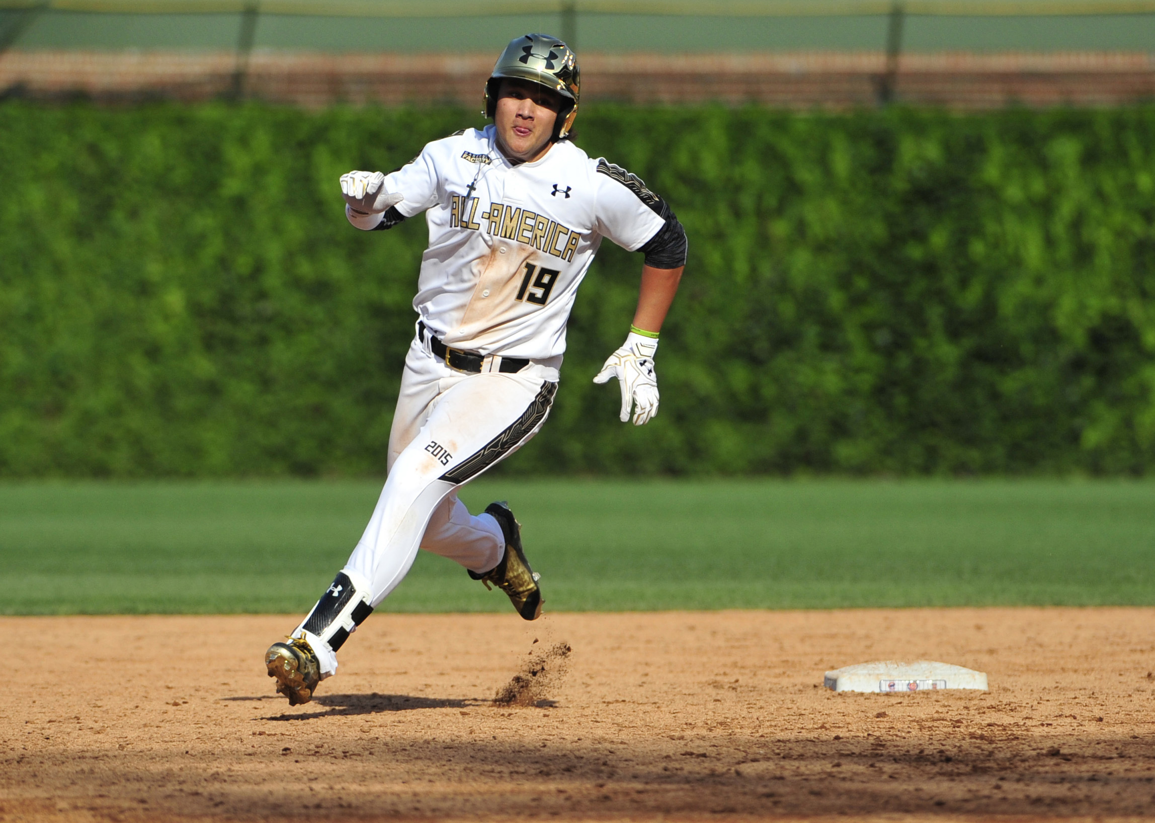 National third baseman Bo Bichette runs the bases on his way to a triple against the American team during the fifth inning in the Under Armour All America Baseball game at Wrigley field. (Photo: David Banks, USA TODAY Sports