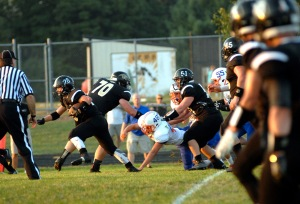 Corydon Central High School junior, Austin Kopp, (28), a running back, breaks from the crowd in Friday night's game against Silver Creek. Sept. 04, 2015