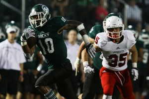 Trinity's Rodjay Burns (10) scored five touchdowns to lead Trinity, and his four receiving scores tied a school record. Trinity went on to beat the Generals, 70-14, at Trinity's Harry Jensing Field. September 4, 2015.