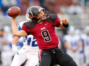 Ballard High School quarterback Kyle Wolfe (9) throws under pressure from Eastern High School's defense during first half of play at Ballard High School in Louisville, Kentucky. September 25, 2015