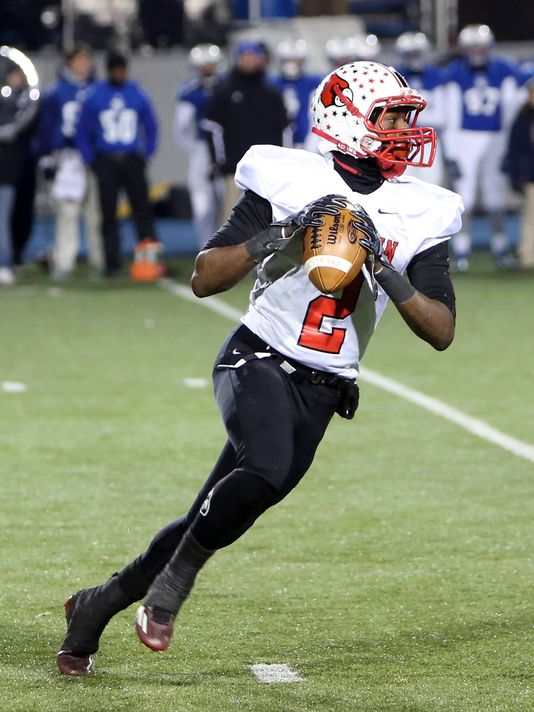 Colerain QB DeShaunte Jones rolls out to pass during his team's Ohio Division I playoff game against St. X in November. (Photo: Enquirer file)