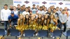 Cohl Cabral is surrounded by his fellow seniors on the football team and the school's cheerleaders (Photo: Intersport)