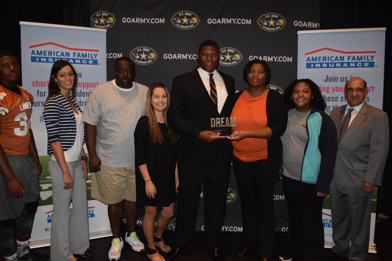Derrick Brown presents his family with the Dream Champion award during the Army All-American Game Selection Tour (Photo: Army All-American Bowl)
