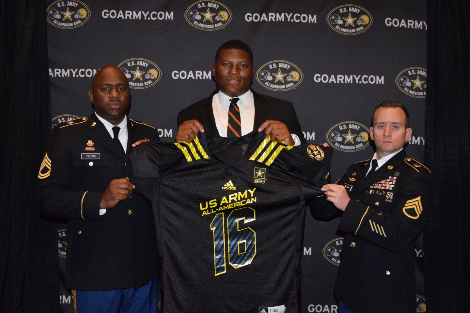 Derrick Brown receiving his U.S. Army All-American Bowl jersey alongside (from left to right) are Sergeant First Class John Fulton and Staff Sergeant Brian Snetana. (Photo: Army All-American Bowl)