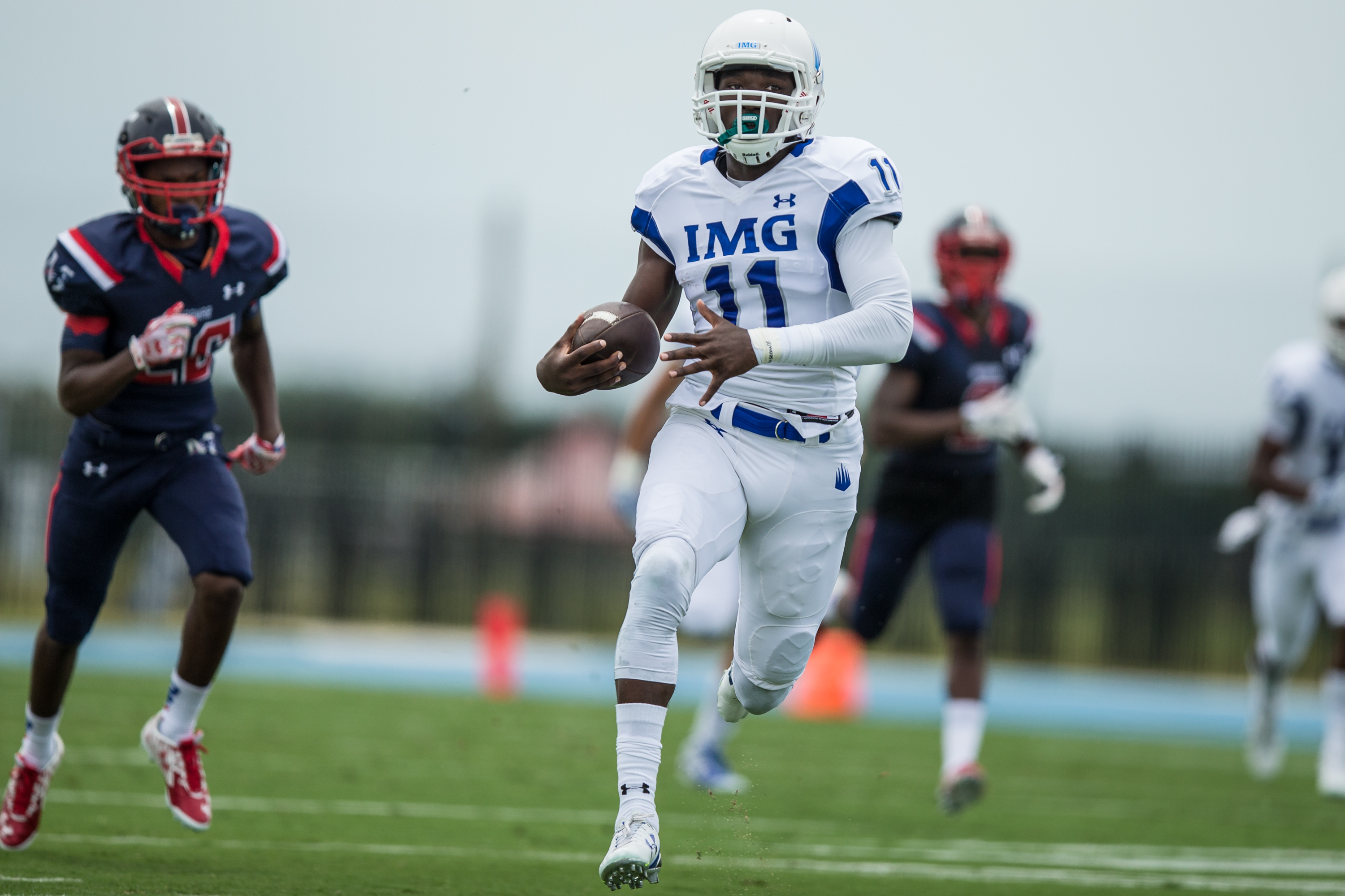 IMG Academy wide receiver Drake Davis (11) returns the ball in the start of the game for a touchdown on Sunday, Aug. 30, 2015 at IMG Academy. (Photo: Travis Pendergrass, Full Focus Photography).