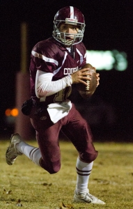 Bullitt Central quarterback, Cameron Dukes (12) runs the ball in the second half of play against South Oldham at Bullitt Central's George Valentine Field.   October 31, 2014.
