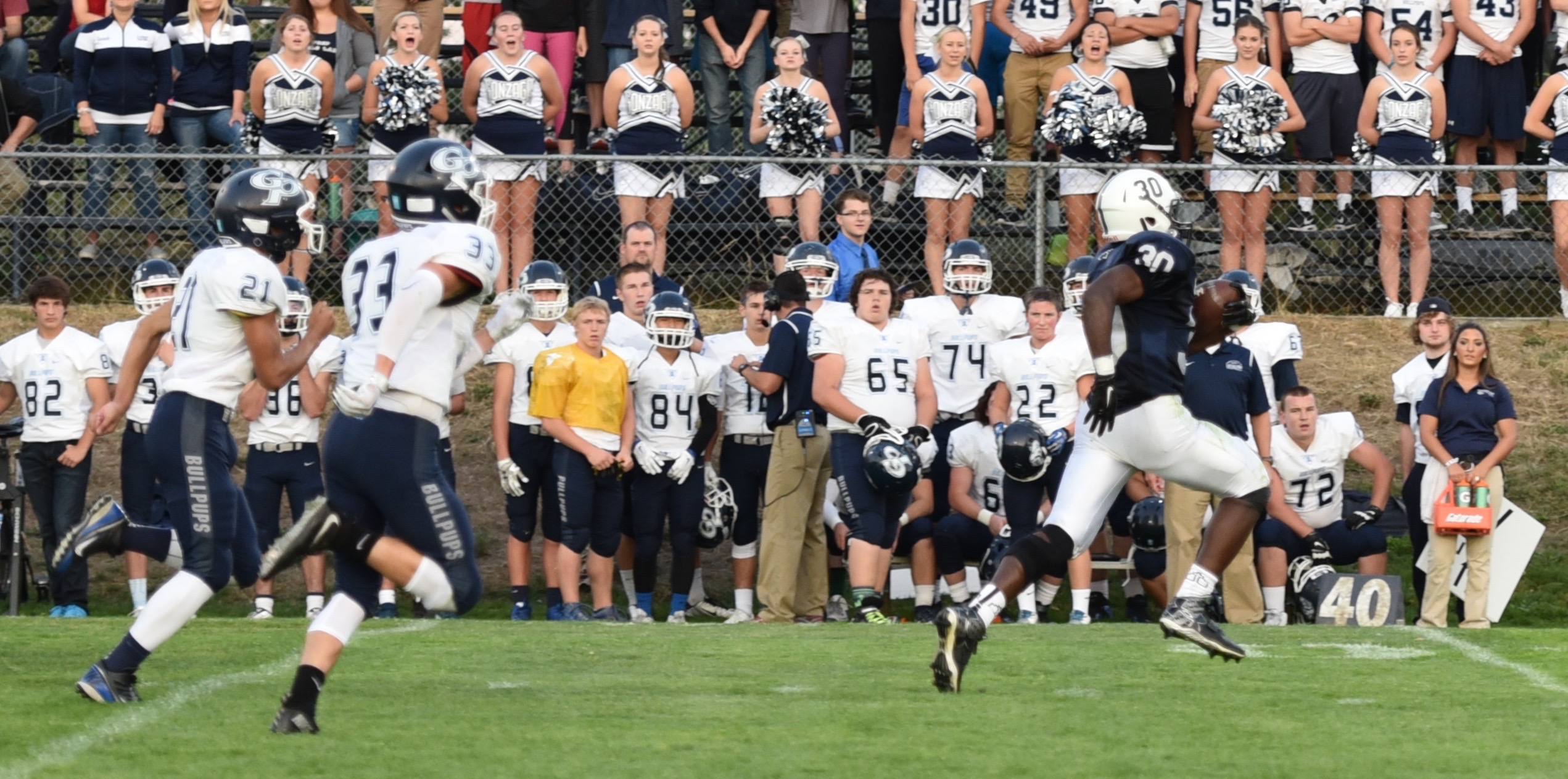 Senior Ahmad Lewis breaks away for a 77 yard touchdown. Photo by Susie Gray