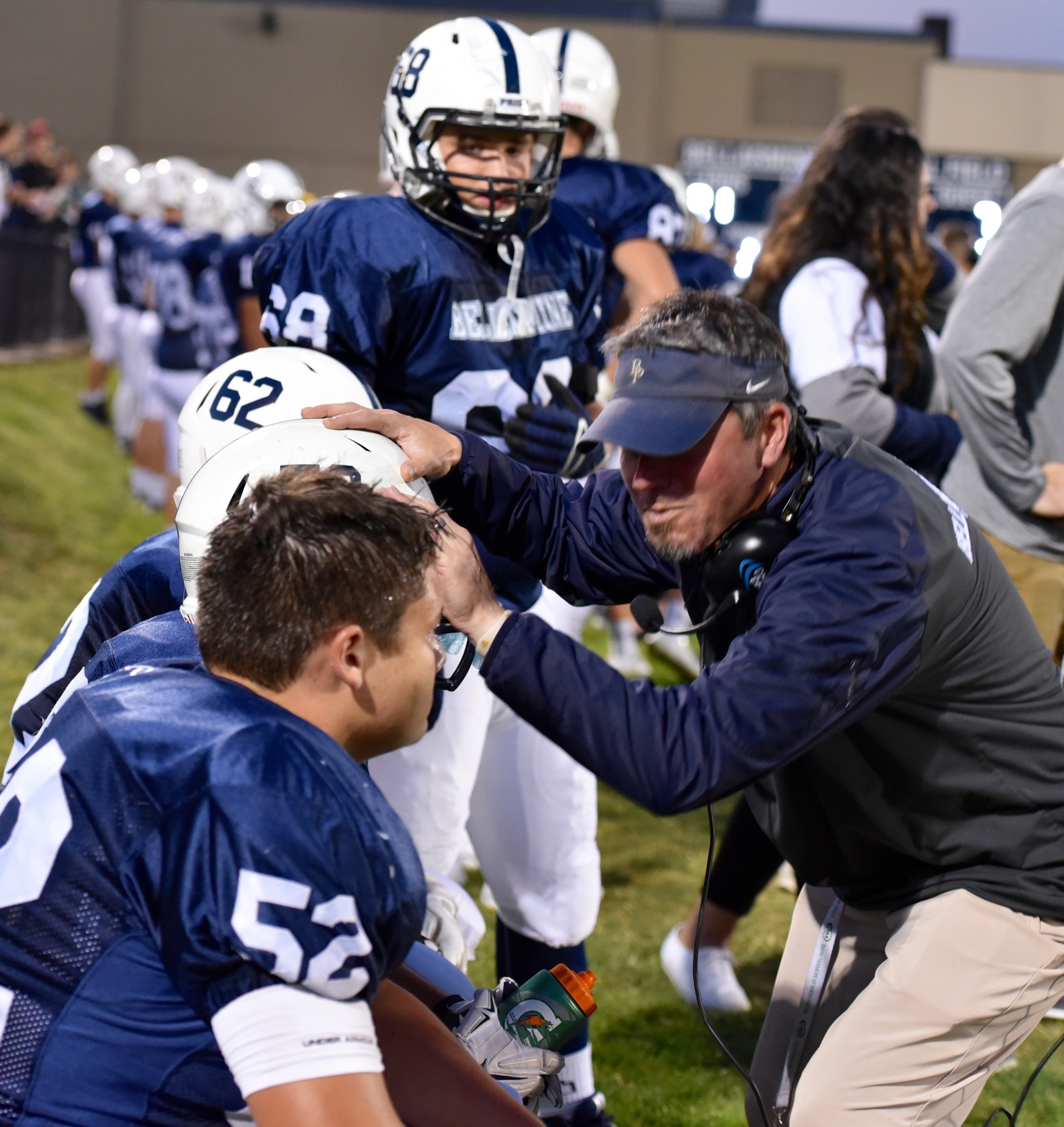 Coach Jensen fires up the offensive line before a big series. Photo by Susie Gray