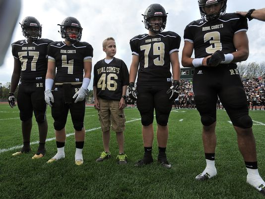Landon Brice (46) served as Rush-Henrietta's honorary captain for the coin flip prior to Saturday's matchup with Monroe County rival Pittsford. R-H lost, 36-33. (Photo: Adrian Kraus, Democrat and Chronicle)