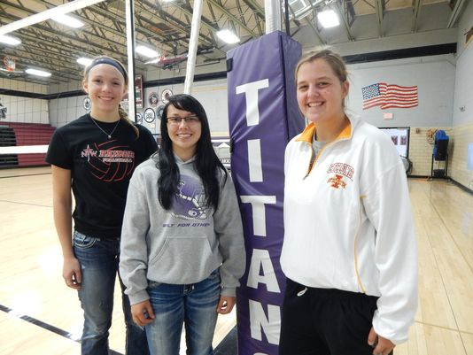 South Central Calhoun volleyball players (from left) Allison Birks, Shelby Kingery and Julia Seil returned to the school's gym after a tornado last May kept the team out. (Photo: John Naughton/The Register)