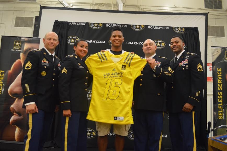 Mique Juarez celebrates receiving his U.S. Army All-American Bowl jersey alongside Sergeant First Class Scott, Sergeant Silva, Sergeant First Class Trevino and Sergeant First Class Jones at his official presentation (Photo: Army All-American Bowl)