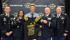 Austin Mack receives his Army All-American Bowl jersey from (from left): Sergeant Eric McKinney, Sergeant First Class Cami Love, Lieutenant Colonel Andy Mack and Captain Nathan Mundy.