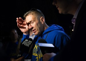 Bremerton (Wash.) assistant football coach Joe Kennedy wipes his eyes as he talks to the media after a 2015 home game. (Lindsey Wasson/The Seattle Times via AP)