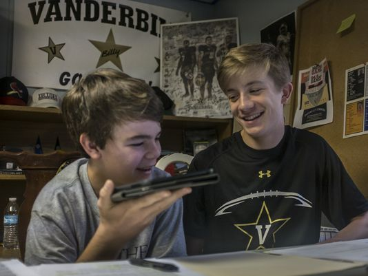 Billy Derrick, right, a 15-year-old sophomore at Father Ryan, and friend Charlie Sheridan, 14,a Father Ryan freshman, broadcast their college football podcast from Billy's basement in the West Meade neighborhood of Nashville. (Photo: John Partipilo, The Tennessean)