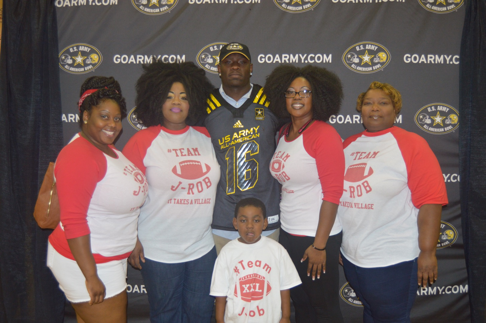 Janarius Robinson is surrounded by his support team as he receives his Army All-American Bowl jersey (Photo: Army All-American Bowl)