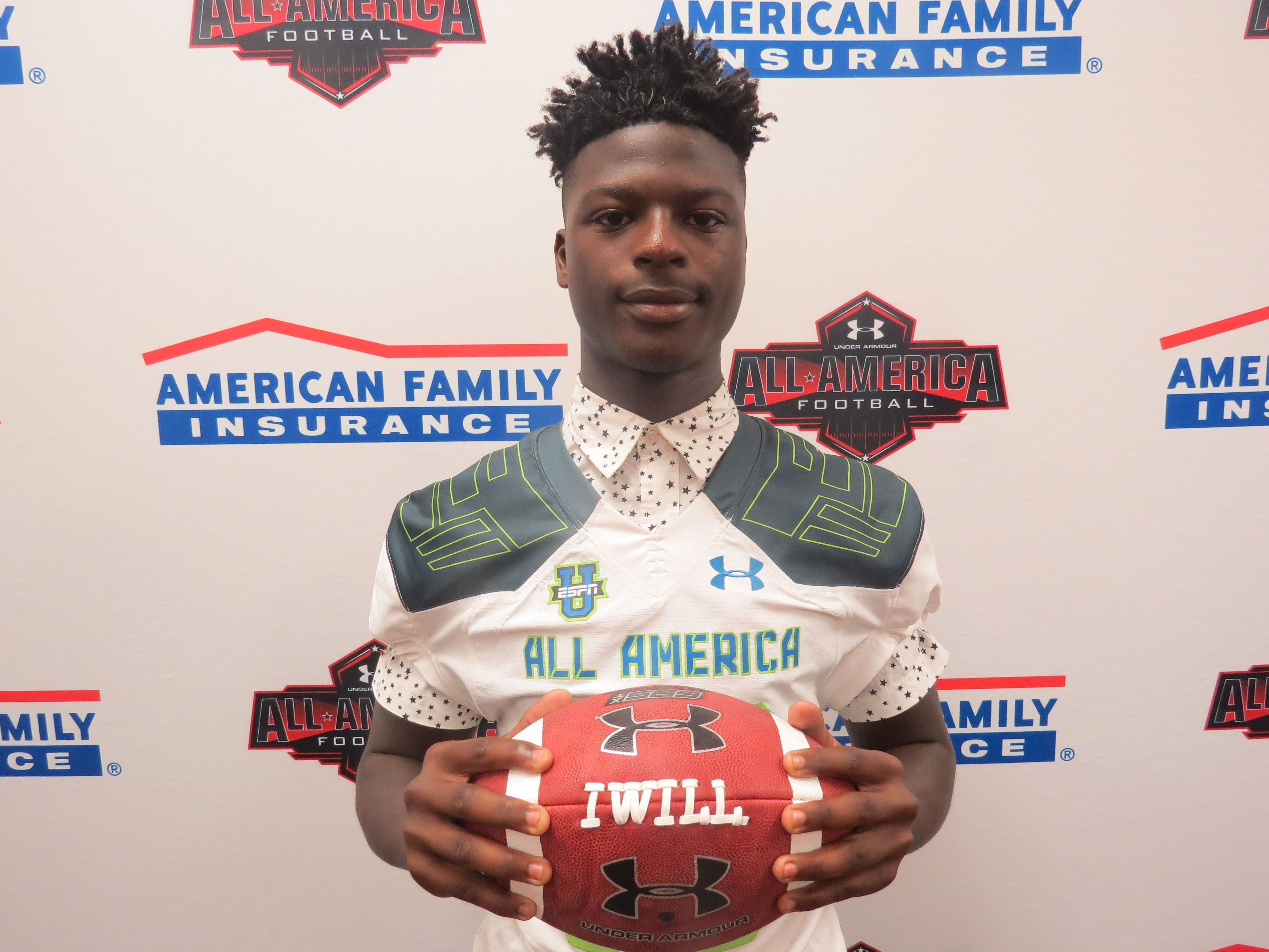 Pasco (Dade City, Fla.) senior cornerback Jayvaughn Myers receives his honorary Under Armour All-America Game jersey. (Photo courtesy of Under Armour and America Family Insurance)