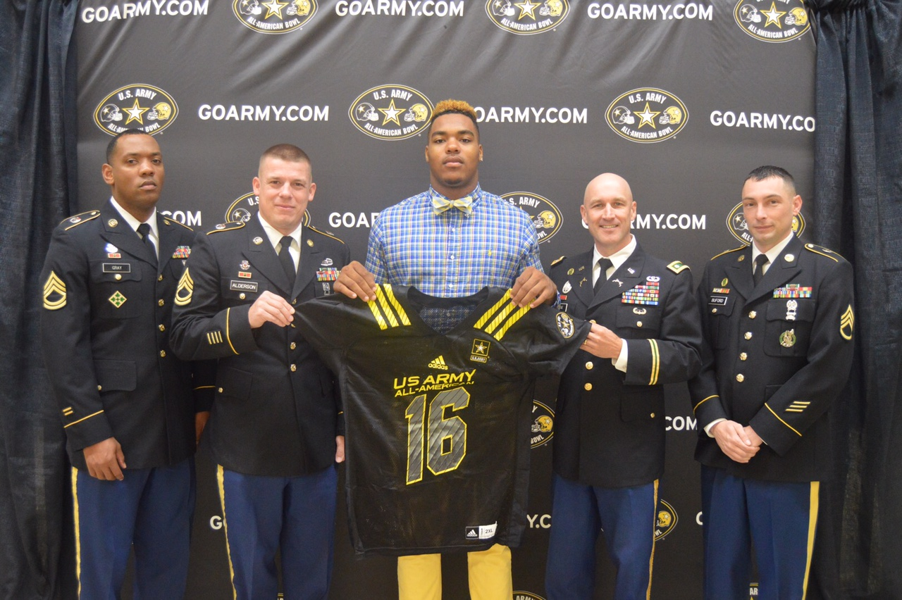 Jeffery Simmons receives his Army All-American Bowl jersey from (from left) Sergeant First Class Kennie Gray, Sergeant First Class Thomas Alderson, Lieutenant Colonel Brian Locke and Staff Sergeant Charles Buford.